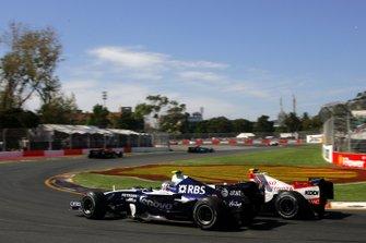 Alex Wurz, Williams FW29 and Jarno Trulli, Toyota TF107