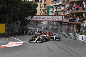 Lewis Hamilton, Mercedes AMG F1 W10, leads Valtteri Bottas, Mercedes AMG W10, Max Verstappen, Red Bull Racing RB15, Sebastian Vettel, Ferrari SF90, and the rest of the field at the start