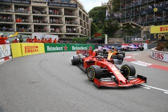 Charles Leclerc, Ferrari SF90, leads Lando Norris, McLaren MCL34, and Lance Stroll, Racing Point RP19