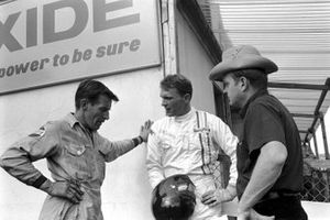 Dan Gurney chats with a couple of acquaintances
