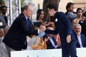 Prince Albert II greets Charles Leclerc, Ferrari, at the Amber Lounge Fashion Show