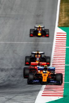 Lando Norris, McLaren MCL34, leads Sebastian Vettel, Ferrari SF90, Max Verstappen, Red Bull Racing RB15, and Pierre Gasly, Red Bull Racing RB15