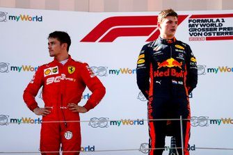 Charles Leclerc, Ferrari and Race winner Max Verstappen, Red Bull Racing on the podium