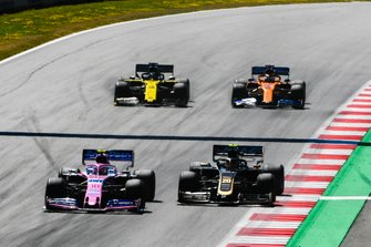 Lance Stroll, Racing Point RP19, leads Kevin Magnussen, Haas F1 Team VF-19, Daniel Ricciardo, Renault F1 Team R.S.19, and Carlos Sainz Jr., McLaren MCL34