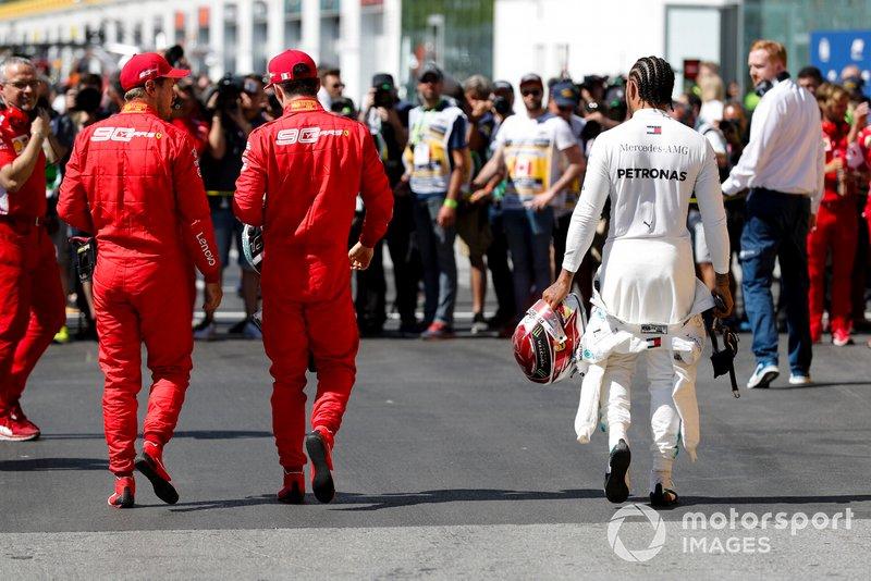 Top three Qualifiers, pole man Sebastian Vettel, Ferrari, third placed Charles Leclerc, Ferrari, and Lewis Hamilton, Mercedes AMG F1, after Qualifying
