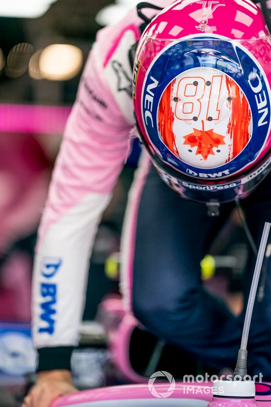 Lance Stroll, Racing Point, climbs into his car