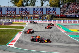 Max Verstappen, Red Bull Racing RB15, leads Sebastian Vettel, Ferrari SF90, Charles Leclerc, Ferrari SF90, Pierre Gasly, Red Bull Racing RB15, and Romain Grosjean, Haas F1 Team VF-19