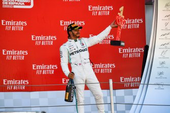 Lewis Hamilton, Mercedes AMG F1, 1st position, on the podium with his trophy and Champagne