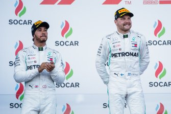 Lewis Hamilton, Mercedes AMG F1, 2nd position, and Valtteri Bottas, Mercedes AMG F1, 3rd position, on the podium