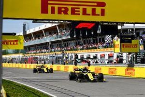 Daniel Ricciardo, Renault R.S.19, leads Nico Hulkenberg, Renault R.S. 19, past the chequered flag