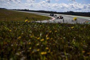 Lando Norris, McLaren MCL35M, George Russell, Williams FW43B