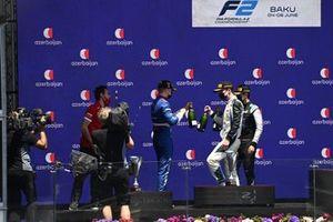 Robert Shwartzman, Prema Racing, 1st position, Dan Ticktum, Carlin, 2nd position, and Guanyu Zhou, Uni-Virtuosi Racing, 3rd position, on the podium