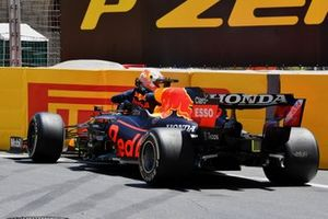 Max Verstappen, Red Bull Racing RB16B, hits a barrier in FP3