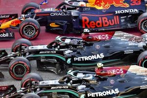 Pole man Lewis Hamilton, Mercedes W12, Max Verstappen, Red Bull Racing RB16B, and Valtteri Bottas, Mercedes W12, arrive in Parc Ferme after Qualifying