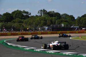Carlos Sainz Jr., Ferrari SF21, Mick Schumacher, Haas VF-21