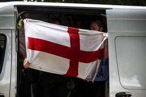 The Mercedes team with an England flag