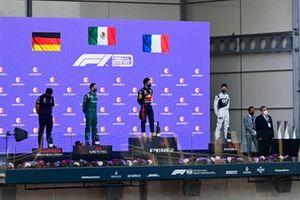 Sergio Perez, Red Bull Racing, 1st position, Sebastian Vettel, Aston Martin, 2nd position, and Pierre Gasly, AlphaTauri, 3rd position, on the podium