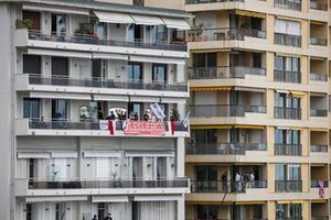 Support for local driver Charles Leclerc, Ferrari, from a balcony