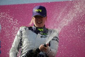 Alice Powell, 1st position, sprays the Champagne