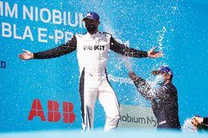 Nick Cassidy, Envision Virgin Racing, third position, sprays Edoardo Mortara, Venturi Racing, first position, with Champagne on the podium