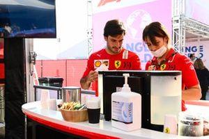 Carlos Sainz Jr., Ferrari, gets a coffee