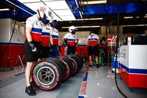 The Haas F1 pit crew in the garage