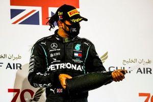 Lewis Hamilton, Mercedes-AMG F1, 1st position, sprays Champagne on the podium