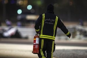 A member of the civil defence with a fire extinguisher