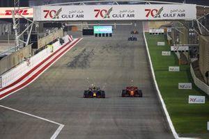 Alex Albon, Red Bull Racing RB16, battles with Charles Leclerc, Ferrari SF1000