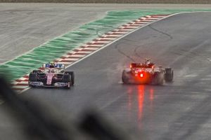 Valtteri Bottas, Mercedes F1 W11, spins as Lance Stroll, Racing Point RP20, passes