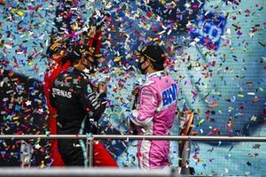 Sebastian Vettel, Ferrari, 3rd position, Lewis Hamilton, Mercedes-AMG F1, 1st position, and Sergio Perez, Racing Point, 2nd position, celebrate on the podium