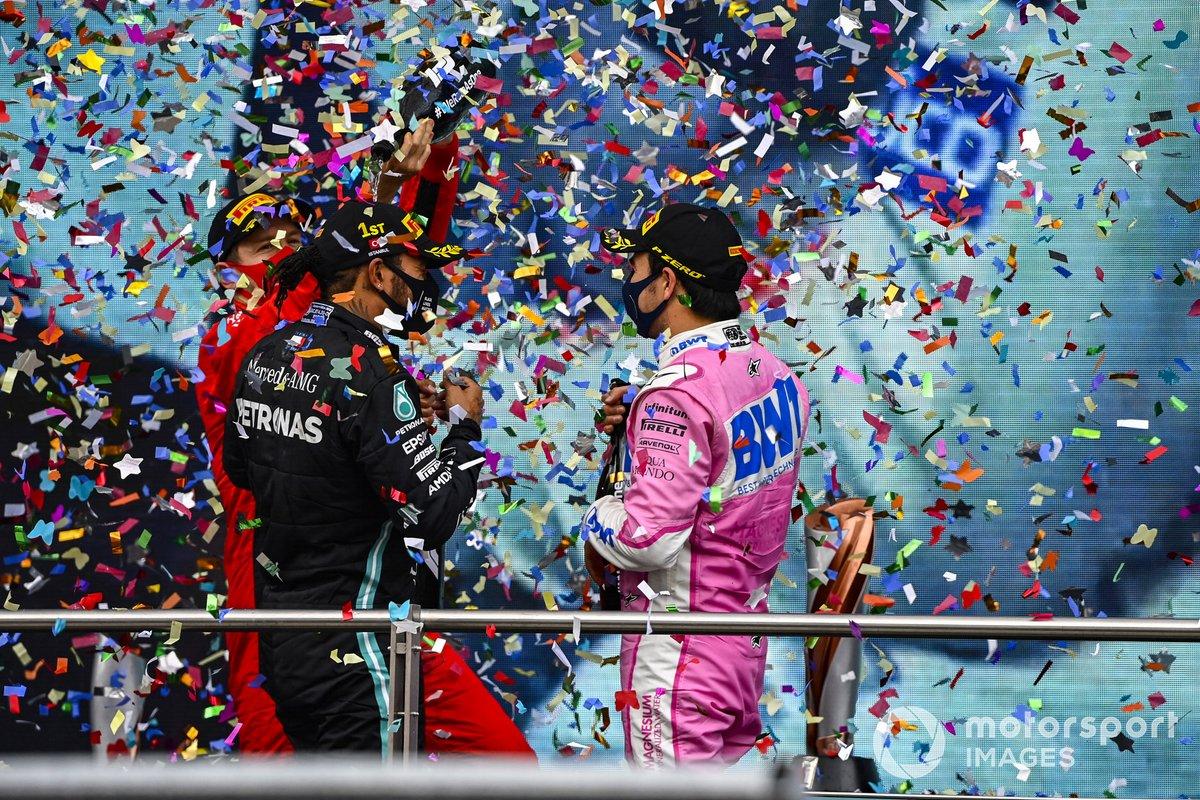 Sebastian Vettel, Ferrari, 3rd position, Lewis Hamilton, Mercedes-AMG F1, 1st position, and Sergio Perez, Racing Point, 2nd position, celebrate on the podium