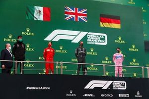 Sebastian Vettel, Ferrari, 3rd position, Lewis Hamilton, Mercedes-AMG F1, 1st position, and Sergio Perez, Racing Point, 2nd position, on the podium