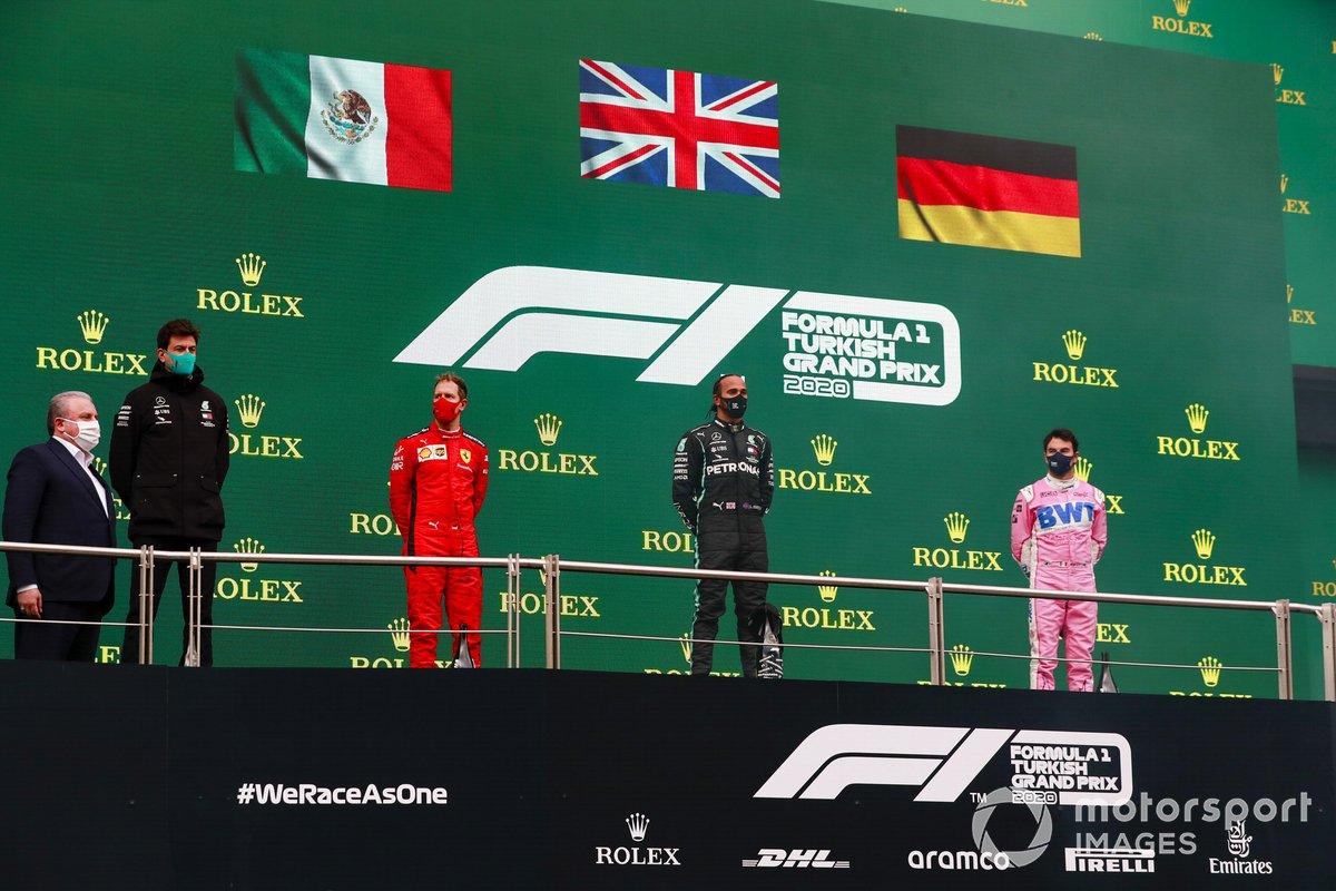 Sebastian Vettel, Ferrari, 3rd position, Lewis Hamilton, Mercedes-AMG F1, 1st position, and Sergio Perez, Racing Point, 2nd position, on the podium