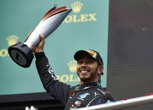 Lewis Hamilton, Mercedes-AMG F1, 1st position, lifts his trophy on the podium