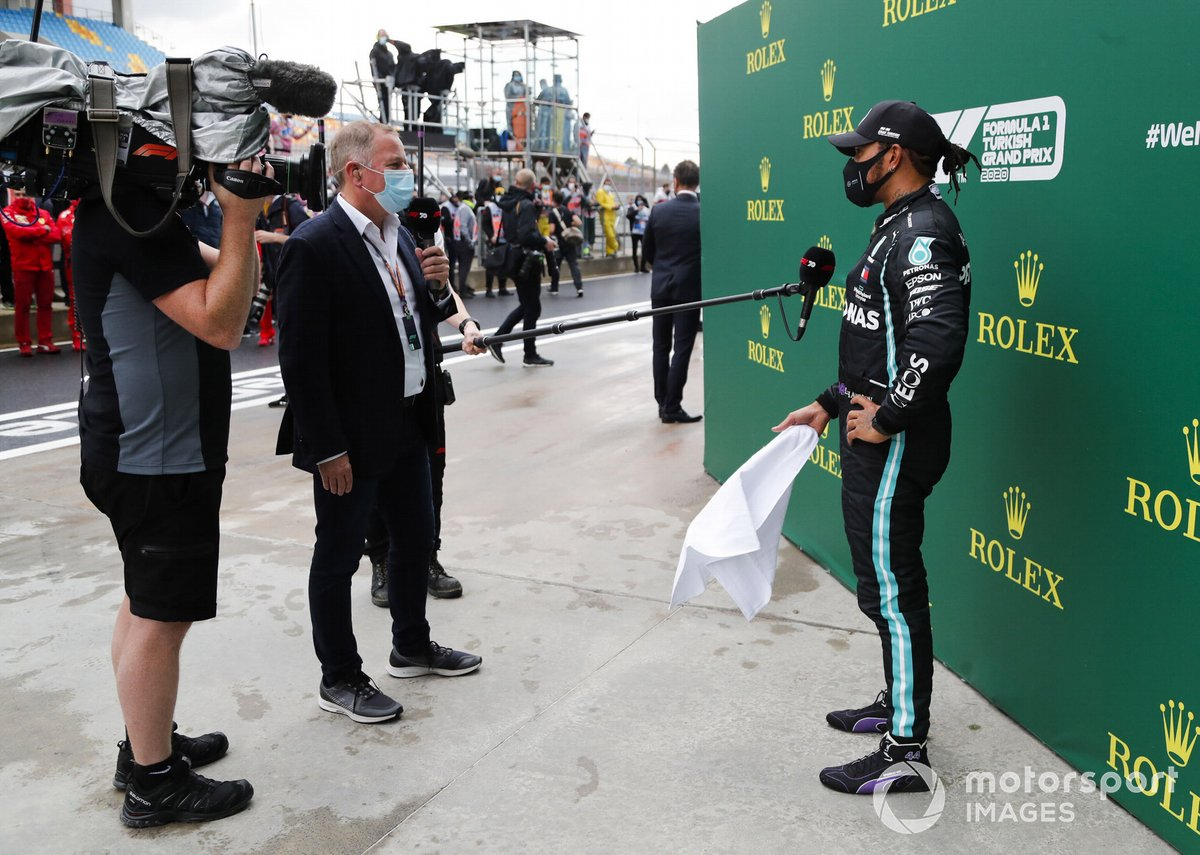 Martin Brundle, Sky TV, interviews Lewis Hamilton, Mercedes-AMG F1, after winning the race, to take his 7th World Championship title
