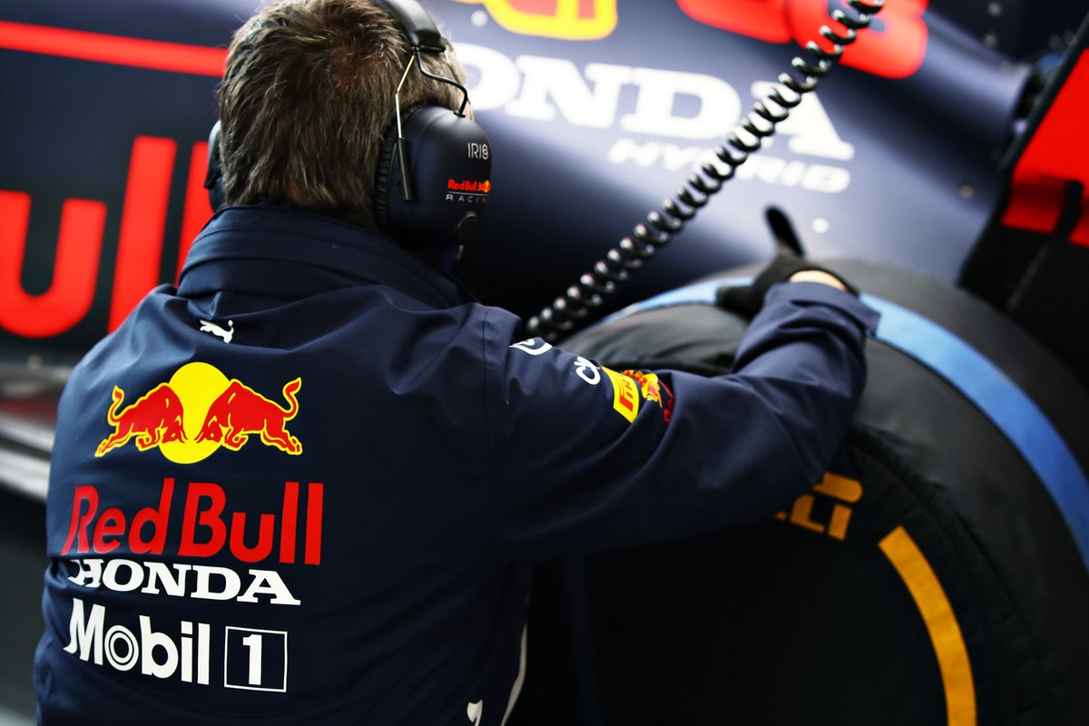 A member of the Red Bull Racing team works in the garage