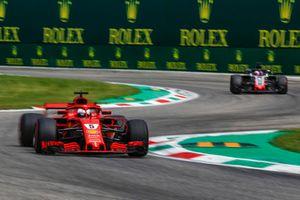 Sebastian Vettel, Ferrari SF71H and Romain Grosjean, Haas F1 Team VF-18