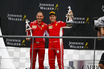 David Sanchez, Principal Aerodynamicist, Ferrari, and Sebastian Vettel, Ferrari, 1st position, with their trophies
