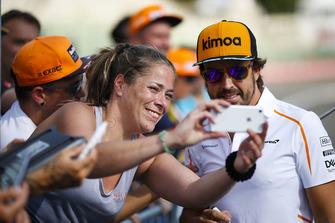 Fernando Alonso, McLaren, has his picture taken by a fan