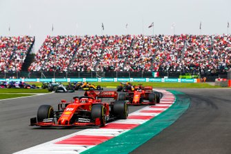 Charles Leclerc, Ferrari SF90 leading Sebastian Vettel, Ferrari SF90 at the start of the race