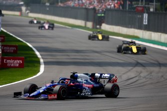 Daniil Kvyat, Toro Rosso STR14, leads Daniel Ricciardo, Renault R.S.19, and Nico Hulkenberg, Renault R.S. 19