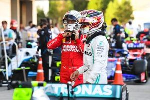 Lewis Hamilton, Mercedes AMG F1, 3rd position, and Sebastian Vettel, Ferrari, 2nd position, in Parc Ferme