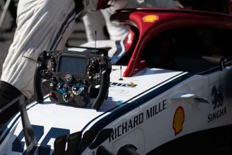 The car and steering wheel of Antonio Giovinazzi, Alfa Romeo Racing C38, on the grid