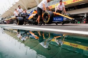 McLaren mechanics push Carlos Sainz Jr., McLaren MCL34 down the pit lane.