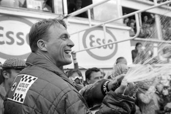 Dan Gurney celebrates his victory