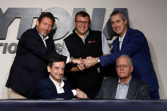 Pierre Fillon, ACO President, Jim France, IMSA Chairman, Gerard Neveu, FIA WEC CEO, John Doonan, IMSA President, and Ed Bennett, IMSA CEO