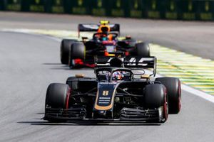 Romain Grosjean, Haas F1 Team VF-19 and Alexander Albon, Red Bull RB15