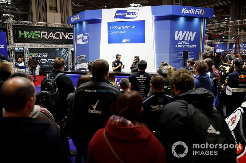 Presenter Matt James interviews Tom Ingram on the BTCC stand
