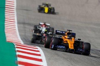 Carlos Sainz Jr., McLaren MCL34, leads Kevin Magnussen, Haas F1 Team VF-19, Kimi Raikkonen, Alfa Romeo Racing C38, and Nico Hulkenberg, Renault F1 Team R.S. 19